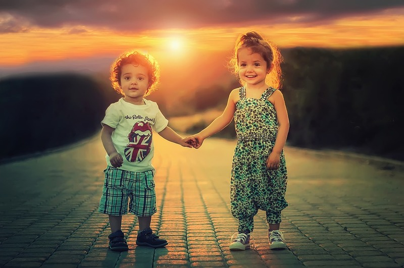 2 children holding hands