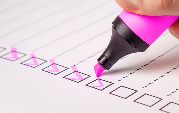 checklist and pink highlighter