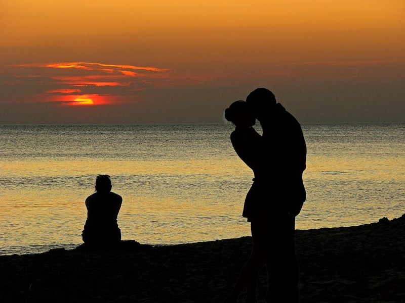 couple hugging by the water  - Build Trust in a Relationship