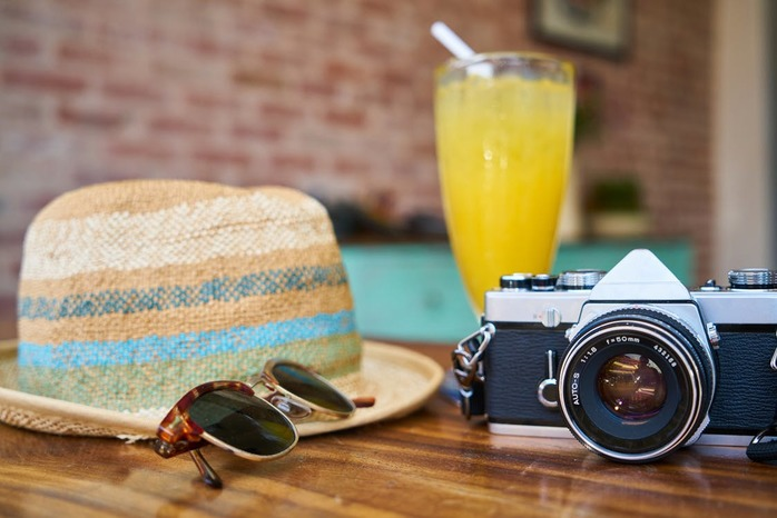 hat, sunglasses, camera, drink