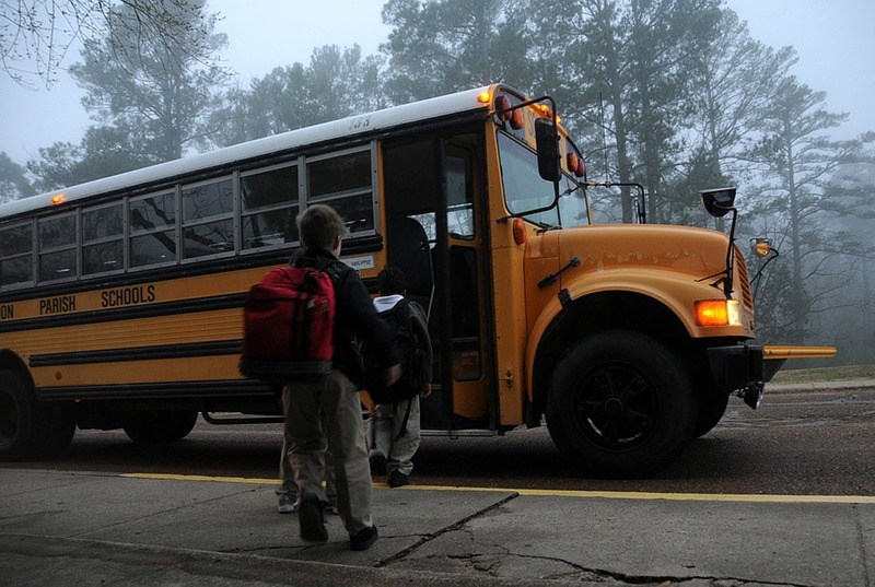 kids getting on the school bus  - Tips to Ease Back to School Anxiety