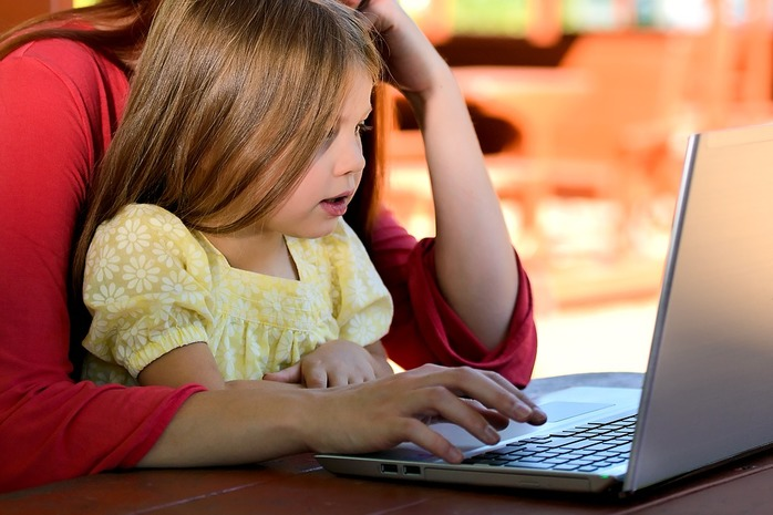 parent and child on computer