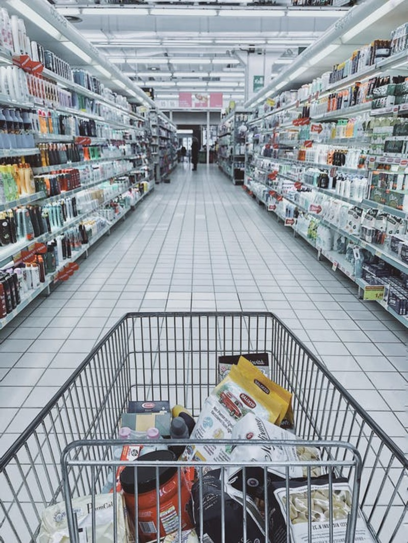 shopping cart with food, store isle way with products