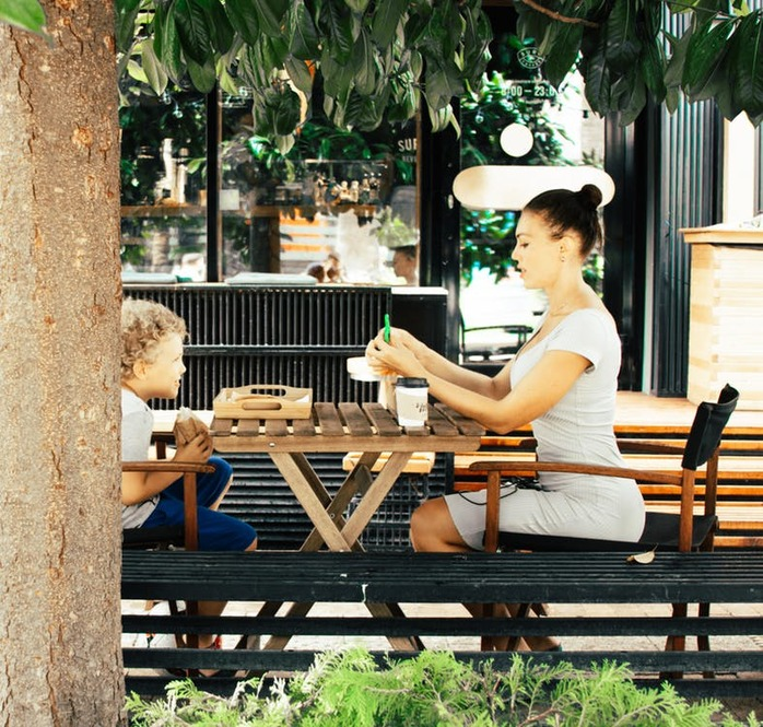 woman and child eating at table