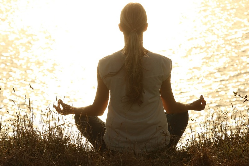 woman sitting in meditation position  - Steps to Support the Healing Process